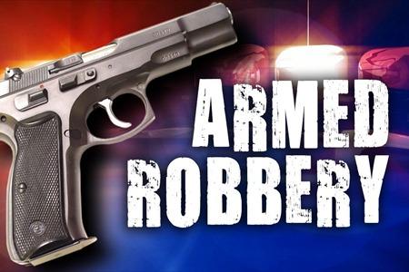 Breaking News: Woman robbed at gunpoint