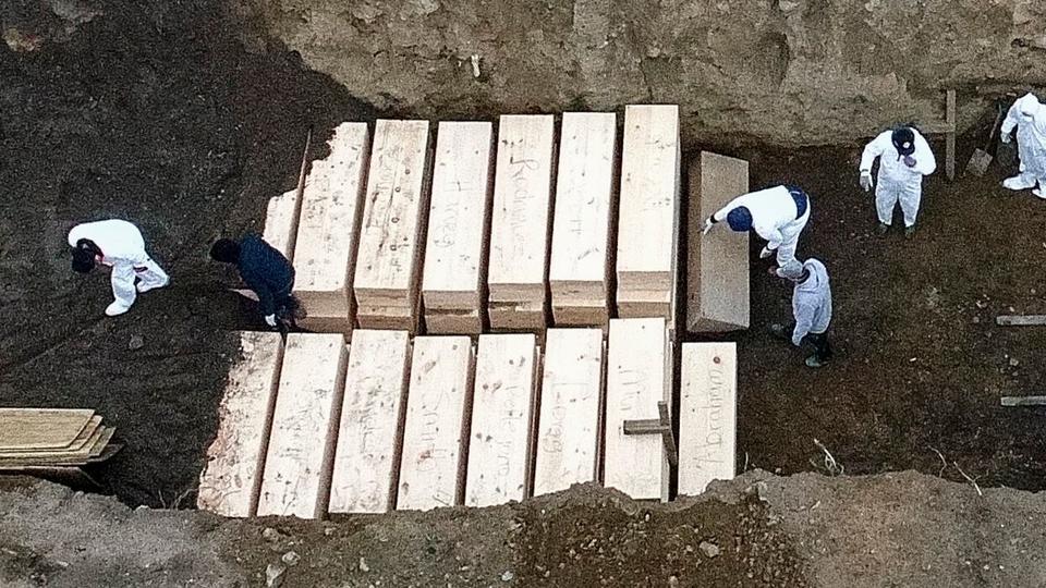Mass burials surge as New York City set to hit 100,000 coronavirus cases