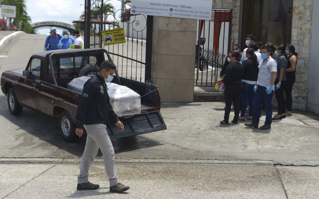 In Ecuador, families wait with their dead as bodies pile up