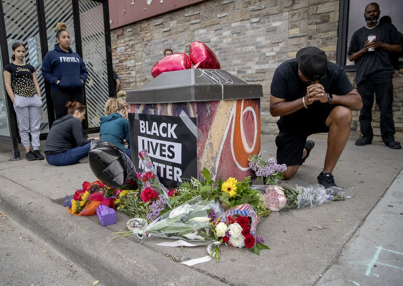 INTERNATIONAL: Four Minneapolis officers fired after death of black man
